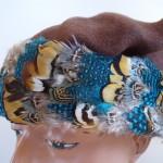 Soñar con sombreros de plumas